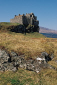 LOOKING ACROSS TO DUART CASTLE (DATING FROM 1250 AND THE SEAT OF THE CLAN MACLEAN) ON DUART POINT, ISLE OF MULL, FROM THE FORESHORE OF THE SOUND OF MULL, INNER HEBRIDES. PIC: VisitScotland/SCOTTISH VI... BUILDING,WINTER,WATER,SUNNY,MOUNTAIN,HILL,HERITAGE,COAST