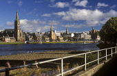 THE VIEW TOWARDS THE GRIEG STREET SUSPENSION FOOTBRIDGE OVER THE RIVER NESS, THE CITY OF INVERNESS, HIGHLAND. PIC: P.TOMKINS/VisitScotland/SCOTTISH VIEWPOINT Tel: +44 (0) 131 622 7174   Fax: +44 (0) 1... BRIDGE,WATER,SUNNY,SUMMER,SPRING,SPIRES,SPIRE,CLOUDS,CASTLE