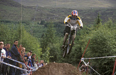 A COMPETITOR TAKES SOME AIR ON A JUMP ON THE DOWNHILL COURSE AT THE 2004 MOUNTAIN BIKE WORLD CUP AT NEVIS RANGE, NEAR FORT WILLIAM, HIGHLAND. PIC: P. TOMKINS/VisitScotland/SCOTTISH VIEWPOINT Tel: +44... 2004,SPORT,SPECTATOR,PEOPLE,HELMET,EVENT,CYCLIST,CYCLING,CYCLE,CROWDS,CROWD,COMPETITION,ACTIVITY
