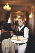 """A WAITRESS WITH A TRAY OF BOWLS OF SOUP SERVES CONFERENCE AND INCENTIVE TRAVEL ORGANISERS DURING LUNCH AT A """"SCOTLAND MEANS BUSINESS"""" EVENT AT THE TURNBERRY HOTEL, SOUTH AYRSHIRE. PIC: P.TOMKINS/Visit... 2004,VENUE,TABLES,SMILE,SMB,SERVING,SERVE,RESTAURANT,MEAL,INTERIOR,HOSPITALITY,FOOD,EVENT,EATING,DELEGATES,DELEGATE,CORPORATE,BTU"""