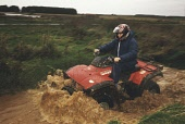 """A CONFERENCE AND INCENTIVE TRAVEL ORGANISER RIDES A QUAD BIKE DURING A """"SCOTLAND MEANS BUSINESS"""" EVENT AT THE TURNBERRY HOTEL, SOUTH AYRSHIRE. PIC: P.TOMKINS/VisitScotland/SCOTTISH VIEWPOINT Tel: +44... 2004,WATER,VENUE,SPLASH,SMB,RESORT,MUD,HOSPITALITY,EVENT,DELEGATE,CORPORATE,BTU,ACTIVITY,ACTION"""
