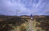 A HILL WALKER PAUSES A MOMENT BY THE PUBLIC FOOTPATH SIGN FOR KINLOCHLEVEN ON THE DEVIL'S STAIRCASE, A SECTION OF THE WEST HIGHLAND WAY AS IT APPROACHES GLEN COE, HIGHLAND. PIC: DAVID ROBERSTON/VisitS... ACTIVITY,WALKING,WALK,SUNNY,SPRING,SIGNAGE,RUCKSACK,PATH,HILLWALKING,HILLWALKER,HILLS,DIRECTIONS