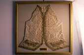 BONNIE PRINCE CHARLIE'S WAIST COAT AT DUNVEGAN CASTLE- DATING FROM 13C WITH MANY ALTERATIONS UP TO 19C AND THE SEAT OF THE CHIEFS OF THE CLAN MACLEOD AND STILL REMAINING THEIR ANCESTRAL HOME, NORTH OF... BUILDING,HERITAGE,EXHIBIT,EXHIBITION,DISPLAY,ISLAND