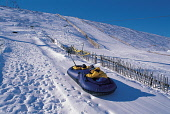 LOOKING UP ONE OF THE SLOPES AS PEOPLE ARE TOWED BACK TO THE TOP FOR ANOTHER EXHILIRATING RIDE OF 'SNOW TUBING' (USING RUBBER RINGS) AT THE LECHT 2090 SKI CENTRE, ABERDEENSHIRE. PIC: P.TOMKINS/VisitSc... Public, NMR