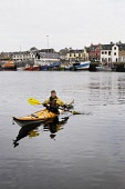 TIM PICKERING (OUTDOOR ACTIVITY INSTRUCTOR, GUIDE AND OWNER) OF ADVENTURE HEBRIDES,  SEA KAYAKING IN STORNOWAY HARBOUR, ISLE OF LEWIS, OUTER HEBRIDES (M/R) AUTUMN