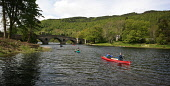 VISITSCOTLAND'S MEDIA ADVENTURE CHALLENGE 2006. CANADIAN CANOEING EVENT ON LOCH TAY AT KENMORE, PERTHSHIRE (ORGANISED BY 'BEYOND ADVENTURE') CANOES PASS UNDER THE BRIDGE, FROM THE LOCH, INTO THE RIVER...