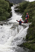 CANYONING IN NORTH GLEN SANNOX ON THE ISLE OF ARRAN - SUMMER 2006.   PIC: P.TOMKINS/VisitScotland/SCOTTISH VIEWPOINT Tel: +44 (0) 131 622 7174   Fax: +44 (0) 131 622 7175 E-Mail : info@scottishviewpoi... ACTIVITY,WATER,SPORT,SCOTLAND,RAPID,JUMP,ISLE,ISLAND,EXTREME,CHILDREN,CHILD