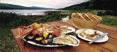A PLATTER OF SCOTTISH SEAFOOD (INCLUDING CRAB, LOBSTER, LANGOUSTINE AND MUSSELLS) ON A TABLE AT THE LOCH FYNE OYSTER BAR WITH THE LOCH BEHIND, ARGYLL.  PIC:PAUL TOMKINS/VisitScotland/SCOTTISH VIEWPOIN... DRINKING,WINE,STILL LIFE,SHELLFISH,RESTAURANT,GLASS,FOOD,FISH,EATING,OVERSEAS MINI GUIDES 2007