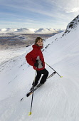 AMANDA FORBES, A MEMBER OF THE  GLENCOE SKI CLUB POSES FOR THE CAMERA BEFORE STARTING HER DESCENT OF THE 'FLY PAPER'  - SCOTLAND'S STEEPEST ON-PISTE RUN AT GLENCOE MOUNTAIN RESORT, HIGHLAND. PIC: P.TO...