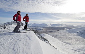 TWO SKIERS  ENJOY THE VIEW FROM NEAR THE SUMMIT OF MEALL A' BHUIRIDH AT THE GLENCOE MOUNTAIN RESORT, HIGHLAND. PIC: P.TOMKINS/VisitScotland/SCOTTISH VIEWPOINT  Tel: +44 (0) 131 622 7174  Fax: +44 (0)... SKIING,WINTER SNOW,SKI