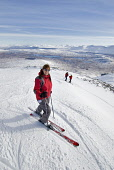 A GROUP OF SKIERS (MEMBERS OF THE GLENCOE SKI CLUB) NEAR THE TOP OF THE 'SRING RUN' WITH RANNOCH MOOR IN THE DISTANCE, AT THE GLENCOE MOUNTAIN RESORT, HIGHLAND.  PIC: P.TOMKINS/VisitScotland/SCOTTISH... SKIING,WINTER SNOW,SKI