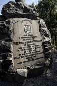 THE MEMORIAL TO THE MASSACRE OF GLENCOE - A CROSS ON A CAIRN IN MEMORY TO THE CLAN OF MACDONALD OF GLENCOE WHO WERE MASSACRED BY GOVERNMENT TROOPS ON 13th FEBRUARY 1692, AT GLENCOE VILLAGE, HIGHLAND.... 2006,HIGHLANDS,SUNNY,SUMMER,MONUMENT,INSCRIPTION,GLEN COE