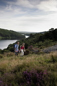 A COUPLE WALKING ABOVE LOCH TROOL - RUNNING SOUTH WEST THROUGH GLEN TROOL IN THE GALLOWAY FOREST PARK, DUMFRIES AND GALLOWAY. PIC: P.TOMKINS/VisitScotland/SCOTTISH VIEWPOINT Tel: +44 (0) 131 622 7174... 2006,WALKERS,TREES,SUMMER,ROMANTIC,FORESTRY,ACTIVITY