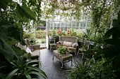 THE CONSERVATORY AT THE HOUSE OF PITMUIES, GUTHRIE,  BY FORFAR, ANGUS. PIC: P.TOMKINS/VisitScotland/SCOTTISH VIEWPOINT Tel: +44 (0) 131 622 7174   Fax: +44 (0) 131 622 7175 E-Mail : info@scottishviewp... 2006,WICKER,SUMMER,SEATING,SEAT,INTERIOR,GEORGIAN,GARDENS,GARDEN,FURNITURE,FLOWERS,BUILDING,ATTRACTION,ARCHITECTURE