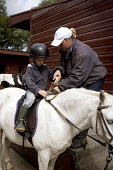 BAREND RIDING CENTRE AT SANDYHILLS ON THE COLVEND COAST, NEAR DALBEATTIE, DUMFRIES AND GALLOWAY.  PIC: PAUL TOMKINS/VisitScotland/SCOTTISH VIEWPOINT Tel: +44 (0) 131 622 7174   Fax: +44 (0) 131 622 71... SUNNY,SUMMER,ACTIVITY,JULY 2006,HORSE,EQUINE,PONY,STABLES,KID,YOUNGSTER,CHILD,TREK,TREKKING