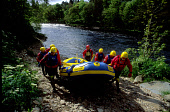 A GROUP OF PEOPLE DRAG THEIR DINGHY ASHORE AFTER AN EXHILIRATING AFTERNOON OF WHITE WATER RAFTING ON THE RIVER TAY AT GRANDTULLY, PERTHSHIRE. PIC: P. TOMKINS/VisitScotland/SCOTTISH VIEWPOINT Tel: +44... PEOPLE,SMILE,SUNNY,SUMMER,LIFE JACKET,ACTIVITY,SPORT,EVENT