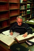 A MAN  SITS AT DESK EXAMINING DOCUMENTS IN NEW REGISTER HOUSE IN THE CITY CENTRE OF EDINBURGH. PIC: P.TOMKINS/VisitScotland/SCOTTISH VIEWPOINT Tel: +44 (0) 131 622 7174   Fax: +44 (0) 131 622 7175 E-M... INTERIOR,PEOPLE,GENEALOGY,FAMILY TREE,HERITAGE,VOLUME,MAGNIFYING GLASS,ANCESTRY,RESEARCH