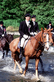 HORSES AND RIDERS MAKE THEIR WAY ACROSS A RIVER NEAR SELKIRK AS PART OF THE COMMON RIDING CELEBRATIONS THAT HAVE TAKEN PLACE EVERY JUNE FOR FIVE CENTURIES AT SELKIRK- A ROYAL BURGH ON A HILL ABOVE THE... SUMMER,PEOPLE,HORSE,ANIMAL,HORSEMAN,EVENT,SUNNY,WATER