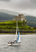 A yacht sailing in the Sound of Mull by Duart Castle on the Isle of Mull, Inner Hebrides.  Picture Credit : Paul Tomkins / VisitScotland / Scottish Viewpoint  Tel: +44 (0) 131 622 7174  E-Mail : info@... Public 2005,summer,activity,visitor,attraction,argyll,island,water,coast,coastal