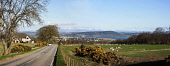 VIEW FROM DRUMMOSSIE BRAE (ALONG THE  OLD PERTH ROAD) OVERLOOKING PART OF INVERNESS, THE KESSOCK BRIDGE AND THE MORAY FIRTH, WITH THE BLACK ISLE AND BEN WYVIS BEYOND, HIGHLANDS OF SCOTLAND. Picture Cr... Public 2006,spring,sunny,panoramic,city,field,fields,sheep,car