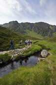 A GROUP OF WALKERS ON A PATH BESIDE THE FEE BURN - ON A RANGER LED BOTANICAL / NATURE TRIP INTO CORRIE FEE, (A NATIONAL NATURE RESERVE ABOVE GLEN DOLL & GLEN CLOVA, ANGUS. ) Public