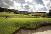 A GOLFER PUTTING ON A GREEN ON THE COURSE AT THE LOTHIANBURN GOLF CLUB, IN THE PENTLANDS (PENTLAND HILLS), JUST A FEW MILES TO THE SOUTH OF EDINBURGH CITY CENTRE. COURSE DESIGNED BY JAMES BRAID.  PIC:... ACTIVITY,SPORT,SUMMER,SPRING,2006,GOLFING