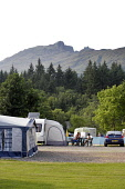 TOURING CARAVANS PITCHED ON THE ARDGARTEN CARAVAN AND CAMPING SITE AT ARROCHAR IN THE ARGYLL FOREST PARK. THE MOUNTAIN OF BEN ARTHUR ('THE COBBLER') IS VISIBLE IN THE DISTANCE. PIC: P.TOMKINS/VisitSco... SUMMER,ACCOMMODATION,CAMPSITE,PEOPLE,MUNRO,PITCH,FACILITIES,2006