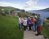 A FAMILY GROUP OF ORCUTTS FROM AMERICA (USA) ALL RELATED TO THE CLAN URQUHART, VISIT URQUHART CASTLE BESIDE LOCH NESS, NEAR DRUMNADROCHIT IN SEPTEMBER 2006. ORGANISED AND LED BY ALASTAIR CUNNINGHAM OF... GENEALOGY,HERITAGE,HISTORICAL,ANCESTRY,ANCESTRAL TOURISM,FAMILY HISTORY,HIGHLAND,HIGHLANDS,SUMMER,SUNNY