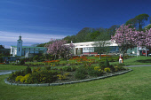 LOOKING OVER NEATLY TENDED FLOWER BORDERS TO CORRAN HALLS, OBAN - A TOWN AND RESORT IMPORTANT REGARDING ITS FERRY CONNECTIONS TO THE INNER AND OUTER HEBRIDES, ARGYLL. Picture: SUE ANDERSON / SCOTTISH... BUILDING,SUNNY,SPRING,PEOPLE,OLD LADY,ELDERLY,CHERRY BLOSSOM