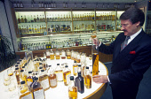 A MASTER BLENDER WITH A SELECTION OF WHISKIES. PIC: GLYN SATTERLEY/SCOTTISH VIEWPOINT Tel: +44 (0) 131 622 7174   Fax: +44 (0) 131 622 7175 E-Mail : info@scottishviewpoint.com This photograph can not... BOTTLE,WHISKY,SCOTLAND,MIX,MALT,INTERIOR,INDUSTRY,BUSINESS,BOTTLES