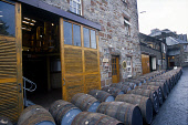 LOOKING OVER TO WHISKY BARRELS LINED UP OUTSIDE THE GLENMORANGIE DISTILLERY, TAIN, HIGHLAND. PIC: GLYN SATTERLEY/SCOTTISH VIEWPOINT Tel: +44 (0) 131 622 7174   Fax: +44 (0) 131 622 7175 E-Mail : info@... BARREL,WHISKY,SCOTLAND,MANUFACTURE,INDUSTRY,CASKS,CASK