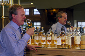 WHISKY SAMPLING AT A DISTILLERY. PIC: GLYN SATTERLEY/SCOTTISH VIEWPOINT Tel: +44 (0) 131 622 7174   Fax: +44 (0) 131 622 7175 E-Mail : info@scottishviewpoint.com This photograph can not be used withou... BOTTLE,WHISKY,TASTING,TASTE,SCOTLAND,SAMPLE,PEOPLE,NOSING,NOSE,MIRROR,MALT,INTERIOR,BOTTLES