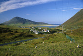 LOOKING OVER TO THE SETTLEMENT OF TAOBH TUATH (NORTHTON)- A VILLAGE ON THE WEST COAST OF THE ISLE OF HARRIS, WITH THE PEAK OF CAIPAVAL AND TOE HEAD VISIBLE BEYOND, OUTER HEBRIDES. PIC: SUE ANDERSON/SC... BEACH,WATER,TELEGRAPH POLES,SUNNY,SUMMER,SHEEP,SETTLEMENT,SAND SANDY,HOUSING,COMMUNITY,COAST