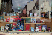Bookseller Christopher Rowley re-arranges his 'Harry Potter' window display in  Aberfeldy- J.K.Rowling  has purchased a house on the outskirts of the town, Perth & Kinross. Photo: Simon Grosset / Scot... LITERARY,SHOPPING,SHOP,RETAIL,PEOPLE