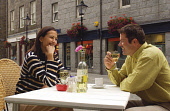 A COUPLE ENJOY AN AL FRESCO DRINK.   PIC: S.BUCHANAN/SCOTTISH VIEWPOINT Tel: +44 (0) 131 622 7174   Fax: +44 (0) 131 622 7175 E-Mail : info@scottishviewpoint.com This photograph can not be used withou... DRINKING,WINE,SUMMER,SMILE,ROMANTIC,ROMANCE,RESTAURANT,OUTSIDE,OUTDOOR,LIFESTYLE,DRINKS