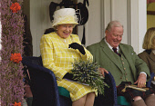 THE QUEEN ENJOYS THE PROCEEDINGS OF THE BRAEMAR GATHERING HELD ANNUALLY IN SEPTEMBER AT BRAEMAR, ABERDEENSHIRE.PIC: S.BUCHANAN/SCOTTISH VIEWPOINTTel: +44 (0) 131 622 7174  Fax: +44 (0) 131 622 7175E-M... AUTUMN,SMILE,SCOTLAND,ROYAL,ROYALS,ROYALTY,EVENT,BOUQUET,HIGHLAND,GAMES