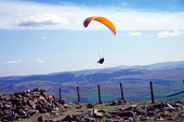 PARAGLIDING AROUND THE SUMMIT OF TINTO HILL, NEAR BIGGAR, SOUTH LANARKSHIRE. PIC: IAIN MCLEAN/SCOTTISH VIEWPOINT Tel: +44 (0) 131 622 7174   Fax: +44 (0) 131 622 7175 E-Mail : info@scottishviewpoint.c... ACTIVITY,SUNNY,SUMMER,PARAGLIDER,FLYING,EXTREME SPORTS