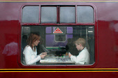 LOOKING INTO ONE OF THE CARRIAGES [INSIDE WHICH A MOTHER AND HER SON PLAY A CARD GAME] OF THE JACOBITE STEAM TRAIN AS IT WAITS IN THE STATION AT GLENFINNAN, HIGHLAND. PIC: S. GROSSET/SCOTTISH VIEWPOIN... CARDS,TRANSPORT,SUNNY,SUMMER,PEOPLE