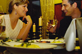 A COUPLE ENJOY A ROMANTIC MEAL IN A RESTAURANT.   PIC: S.BUCHANAN/SCOTTISH VIEWPOINT Tel: +44 (0) 131 622 7174   Fax: +44 (0) 131 622 7175 E-Mail : info@scottishviewpoint.com This photograph can not b... CANDLES,WINE,SMILE,ROMANCE,LIFESTYLE,INTERIOR,DRINKS,DRINKING