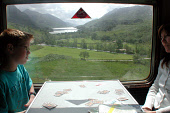 PASSENGERS TAKE IN THE VIEW FROM THE JACOBITE STEAM TRAIN AS IT JOURNEYS BETWEEN FORT WILLIAM AND MALLAIG, HIGHLAND. PIC: S. GROSSET/SCOTTISH VIEWPOINT Tel: +44 (0) 131 622 7174   Fax: +44 (0) 131 622... CARDS,TRANSPORT,SUMMER,PEOPLE,LOCH,FAMILY,CHILD