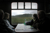ELDERLY PASSENGERS TAKE IN THE VIEW FROM THE JACOBITE STEAM TRAIN AS IT JOURNEYS BETWEEN FORT WILLIAM AND MALLAIG, HIGHLAND. PIC: S. GROSSET/SCOTTISH VIEWPOINT Tel: +44 (0) 131 622 7174   Fax: +44 (0)... PEOPLE,WINDOW,TRANSPORT,SUMMER