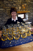 A WELCOMING DRAM AT ABERFELDY DISTILLERY, PERTHSHIRE.PIC: GLYN SATTERLEY/SCOTTISH VIEWPOINT.Tel: +44 (0) 131 622 7174  Fax: +44 (0) 131 622 7175E-Mail : info@scottishviewpoint.comThis photograph can n... BUSINESS,WHISKY,SMILE,INTERIOR,INDUSTRY,GLASSES,GLASS,DRINK,CHEERY