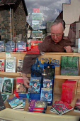 Bookseller Christopher Rowley re-arranges his 'Harry Potter' window display in  Aberfeldy- J.K.Rowling  has purchased a house on the outskirts of the town, Perthshire.Photo: Simon Grosset / Scottish V... LITERARY,SHOPPING,SHOP,RETAIL,PEOPLE