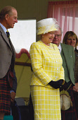THE QUEEN ENJOYS THE PROCEEDINGS OF THE BRAEMAR GATHERING HELD ANNUALLY IN SEPTEMBER AT BRAEMAR, ABERDEENSHIRE.PIC: S.BUCHANAN/SCOTTISH VIEWPOINTTel: +44 (0) 131 622 7174  Fax: +44 (0) 131 622 7175E-M... tourists,tourist,people,person,visitors,visitor,games,royal,royals,royalty,sport,activity,activities,highland,games