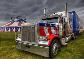 A circus truck by the Big Top, Alloa, Clackmannanshire.  Picture credit : Bill McKenzie / Scottish Viewpoint This photograph cannot be used without prior permission from Scottish Viewpoint. Bill McKenzie / Scottish Viewpoi 2013,summer,atmospheric,HDR,clouds,event,attraction,visitor,visitors,tourist,tourists,tourism,transport,lorry,painted,american,style,flag,flags