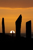 The Stones of Stenness - part of the Heart of Neolithic Orkney World Heritage Site, silhouetted against a setting sun, Harray, Mainland, Orkney. 2013,summer,stone,circle,standing,pagan,age,neolithic,prehistoric,heritage,sunset,dramatic,spectacular,sky,historic,scotland,hs,attraction,visitor,tourist,ancient,monument,henge,archeology,moody,atmos