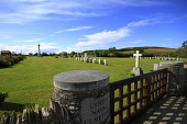 Looking over to the Cross of Sacrifice in the Lyness Royal Naval Cemetery, Hoy, Orkney. 2011,summer,sunny,wartime,servicemen,grave,graves,graveyard,gravestone,religion,commonwealth,world,war,wars,one,two,ww1,ww2,gate,entrance,crosses,memory,memorial,military