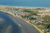 An aerial view of the village of Findhorn with the beach beyond, Moray. 2012,spring,winter,sunny,dramatic,river,estaury,erosion,beach,beaches,sand,sandy,coast,coastal,coastline,water,sea,firth,bay