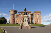 Inverness castle, with the statue of Flora MacDonald in the foreground, Inverness, Highlands of Scotland. Ross Graham / SV 2013,summer,sunny,building,architecture,history,heritage,sheriff,court,flag,saltire,pole,people,couple,city