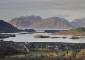 The view over Glencoe Village and Loch Leven to Ballachulish Bridge and the mountains of Morvern beyond, Highlands of Scotland. Stewart Smith / Scottish Viewpoi 2012,winter,atmospheric,sunny,Highland,water,housing,activity,activities,walk,walking,hill,hills,hillwalking,mountain,snow,dusting,dusted
